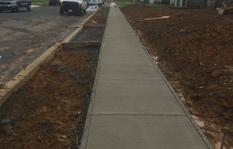 new sidewalk in a suburban housing complex